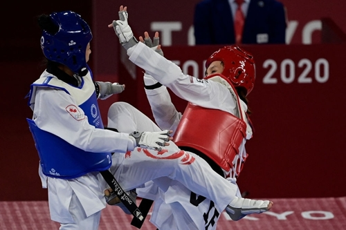 Kim Tuyền thắng áp đảo võ sĩ Canada tại môn taekwondo
