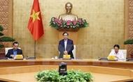 越南政府总理范明政主持政府与工会工作关系会议
